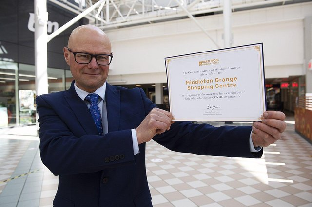 Middleton Grange Shopping Centre Manager Mark Rycraft with the certificate.