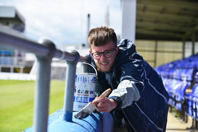 Hartlepool United fan Adam Davison gives Victoria Park a lick of paint ahead of Saturday's game. Picture by FRANK REID