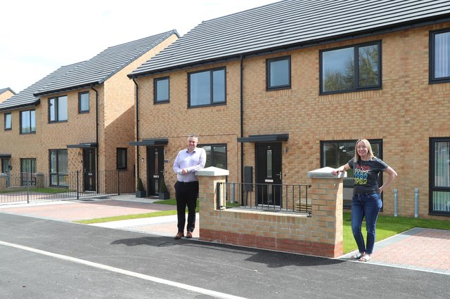 Chris Price, of Tolent with believe housing's Rebecca Marshall at Teign Close, Peterlee.