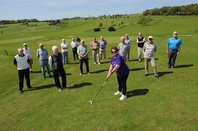 Janice Forbes from Alice House Hospice with members of the High Throston Golf Club senior section who have raised £500 for the charity.
