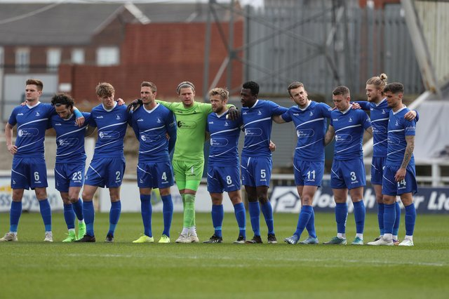 Hartlepool United's players observe a minute silence in remembrance of Lee Collins of Yeovil who died earlier in this week  during the Vanarama National League match between Hartlepool United and Dagenham and Redbridge at Victoria Park, Hartlepool on Friday 2nd April 2021. (Credit: Mark Fletcher   MI News)