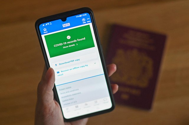 A smartphone screen displays a Covid-19 vaccine record on the NHS app. Picture: Justin Tallis/AFP via Getty Images.