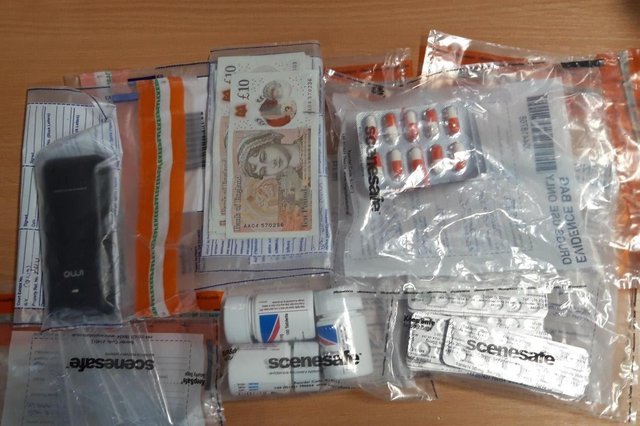 A Cleveland Police picture of the cash and suspected drugs seized in Hartlepool.