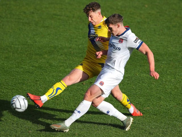 Thomas Peers of Altrincham challenges Reagan Ogle of AFC Fylde during the Emirates FA Cup fourth qualifying round match between AFC Fylde and Altrincham at Mill Farm on October 25, 2020 in Fylde, United Kingdom. (Photo by Alex Livesey/Getty Images)