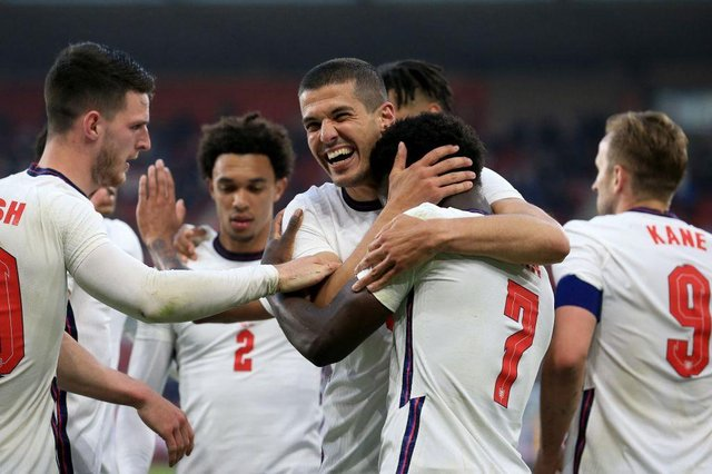 England players celebrate after scoring against Austria.