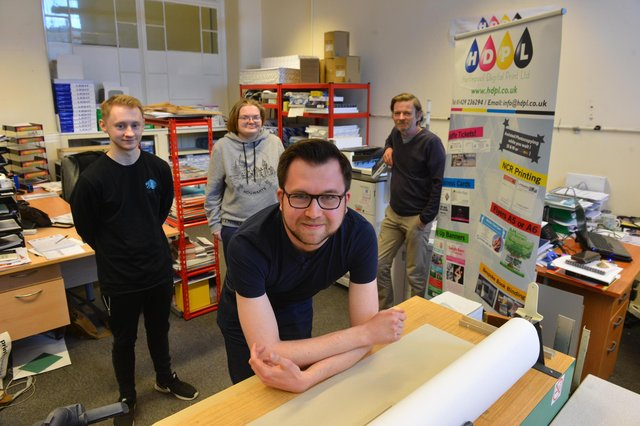 Hartlepool Digital Printing are taking part in the Sir Captain Tom Moore 100 Challenge. Front, Andrew Saint and, back from left, Kenny Doherty, Rachel Cryer and director Paul Cryer.
