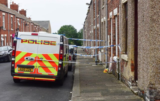 Police cordoned off John Littlewood's home as investigations began into his death in July 2019.
