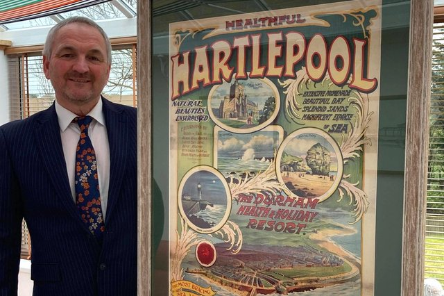 Stephen Close with the original 1906 Healthful Hartlepool poster he is auctioning off.