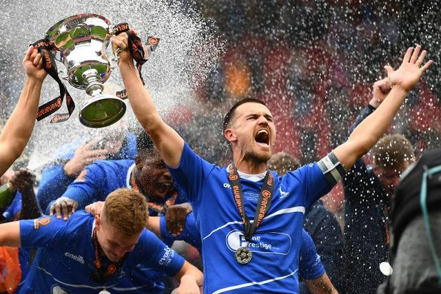 Nicky Featherstone and Ryan Donaldson of Hartlepool United lift the Vanarama National League Trophy during the Vanarama National League Play-Off Final match between Hartlepool United and Torquay United at Ashton Gate on June 20, 2021 in Bristol, England. (Photo by Harry Trump/Getty Images)