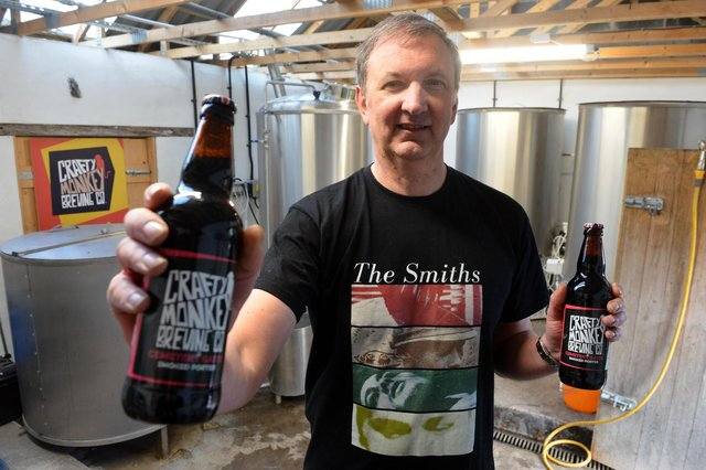 Crafty Monkey Brewing Company director Gary Olvanhill with the new Cemetery Gates beer, named in honour of The Smiths song Cemetry Gates.