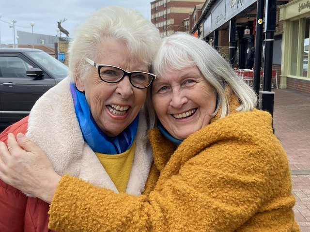 Pat Edgar and friend Pauline hug on reopening day in Hartlepool. Picture by FRANK REID