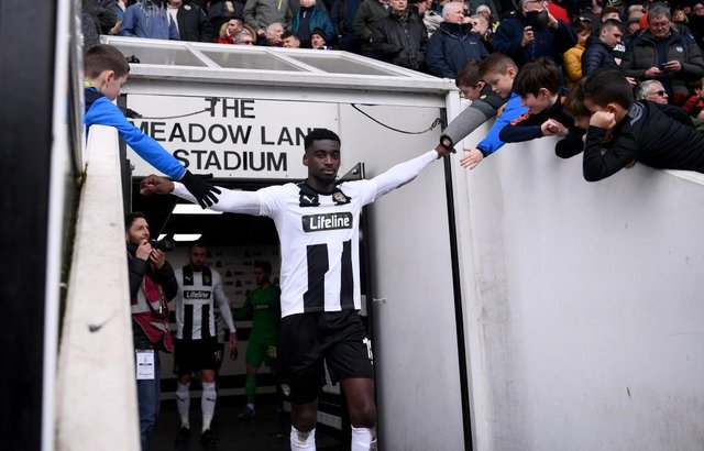 Enzio Boldewijn of Notts County high fives fans. (Photo by Laurence Griffiths/Getty Images)