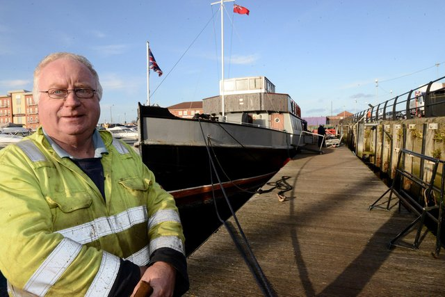 Graham Beesley alongside the MV Coronia which has been restored at Hartlepool Marina. Picture by FRANK REID