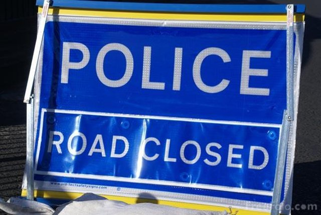 Police have closed Wingate Road as a man is taken to hospital with serious injuries