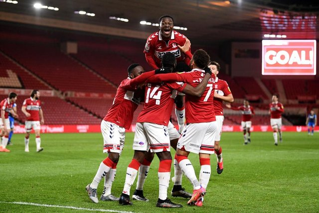 Marcus Tavernier of Middlesbrough celebrates with Marc Bola and team mates after scoring their side's second goal against Preston.