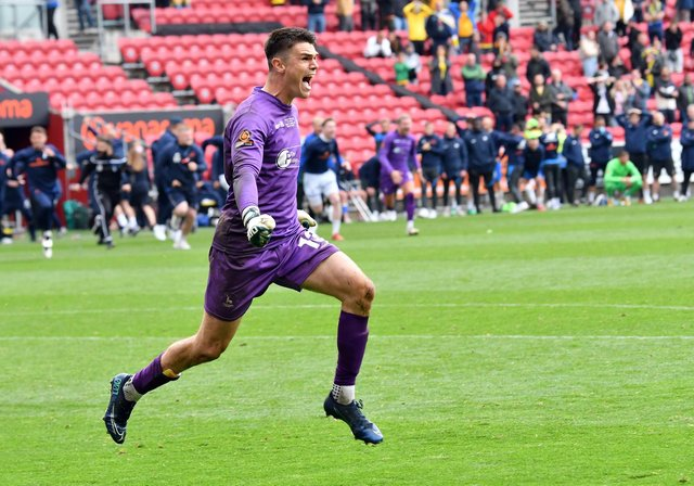 Brad James celebrates his save in the penalty shoot-out that won Pools promotion.