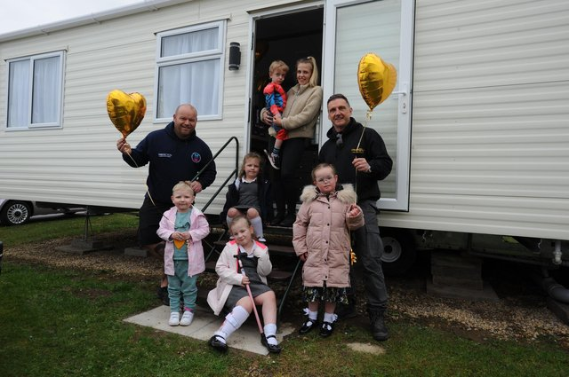 The opening of the Miles For Men new caravan at Crimdon Dene Holiday Park. Pictured are Micky Day from Miles for Men, Darren Cliff from Ambers Law and youngsters Bella Gill, Connie O'Keeffe, Dottie O'Keefe, Noah Griffiths with mum Abbie, and Lacey Robinson.