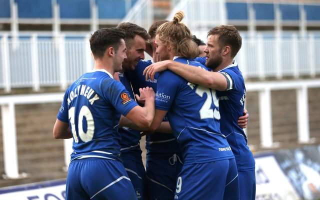 Rhys Oates of Hartlepool United celebrates with team mates after putting his side 1-0 up during the Vanarama National League match between Hartlepool United and Woking at Victoria Park, Hartlepool on Saturday 20th March 2021. (Credit: Chris Booth | MI News)