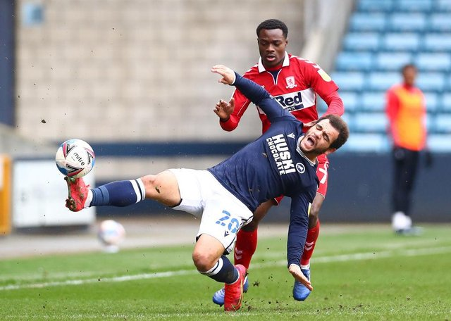 Mason Bennett of Millwall battles for possession with Marc Bola of Middlesbrough.