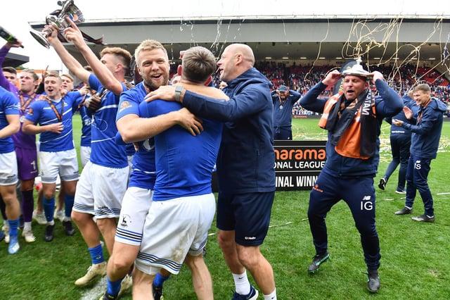 Nicky Featherstone celebrates promotion.