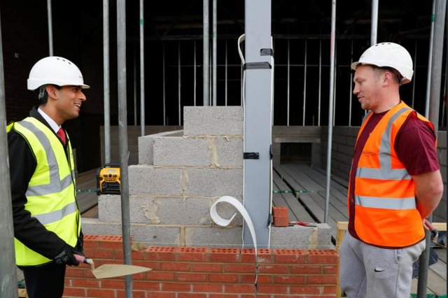 Chancellor of the Exchequer Rishi Sunak talks to bricklayer Danny Honeyman at a construction area during a visit to the Northern School of Art in Hartlepool.