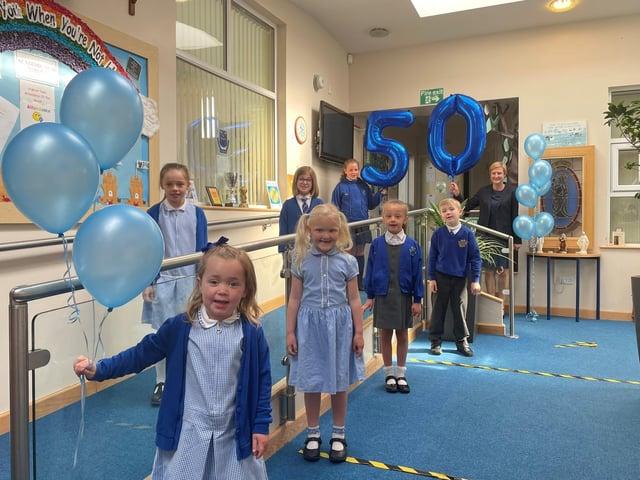 Headteacher Jane Dolphin and St Bega's pupils celebrate the school's 50th birthday.