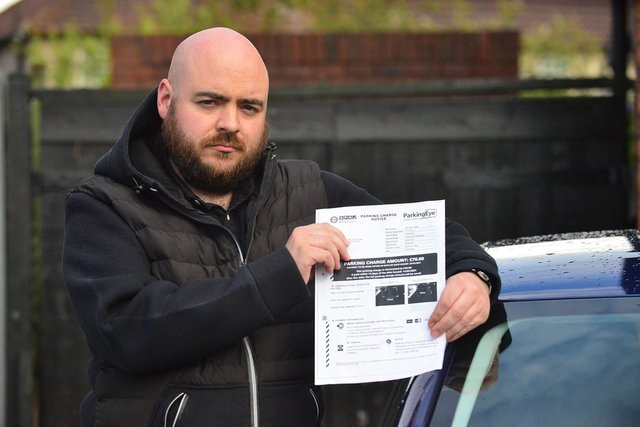 Rick Kitson with his parking fine. Picture by FRANK REID