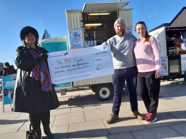 PFC Trust founder Frances Connolly, left, receives the £925 cheque from the Hungry Seagull's owners Karl Campbell and Dorota Bobe