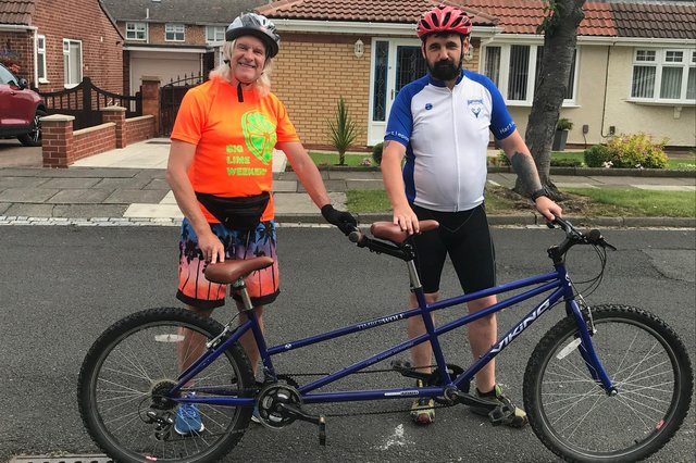 Phil Holbrook (left) and Darrel Slater get ready to ride the tandem.