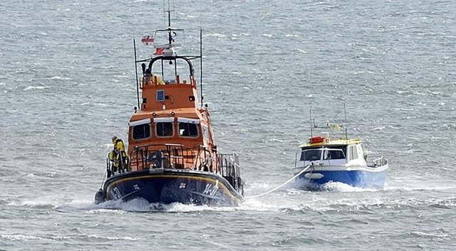 The fishing boat was towed back to safety. Picture: RNLI/Tom Collins