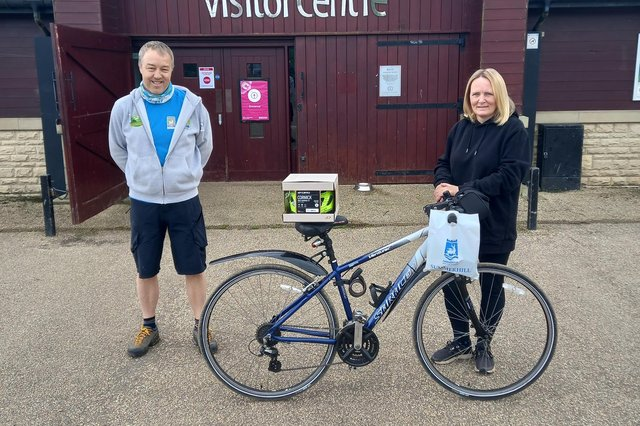 Keith Carter from the Hartlepool Cycle Clinic with 1,000th customer Louise Tate.