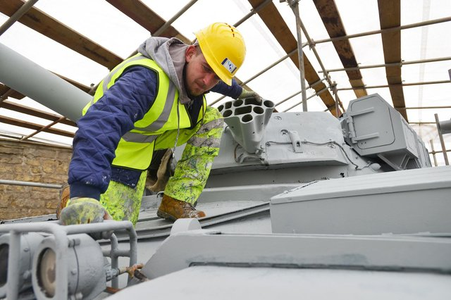 Jake Sleeman from Group Industrial UK Ltd working on a Chieftain Tank undergoing restoration at The Heugh Battery Museum. Picture by FRANK REID