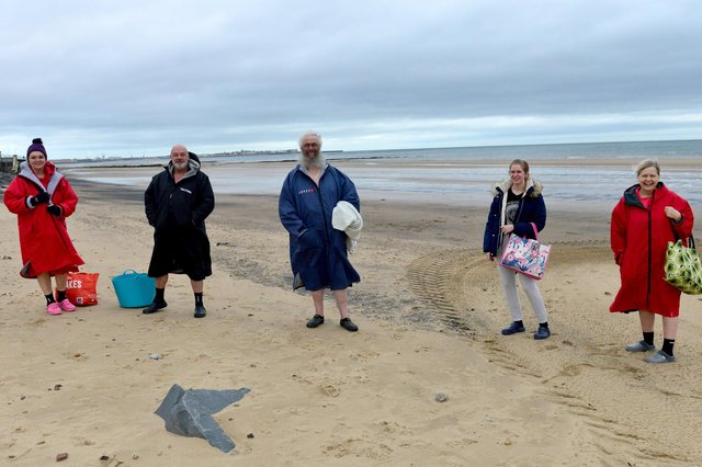 Five swimmers are all set for their swim in the North Sea. Picture by Frank Reid