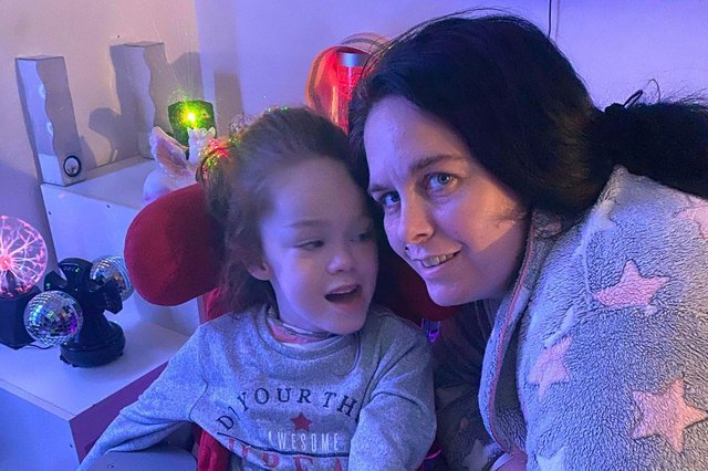Tilly with mum Samantha Malone in her sensory room.
