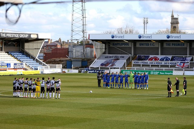 The players mark the death of HRH Price Philip during the Vanarama National League match between Hartlepool United and Notts County at Victoria Park, Hartlepool on Saturday 10th April 2021. (Credit: Chris Booth | MI News)