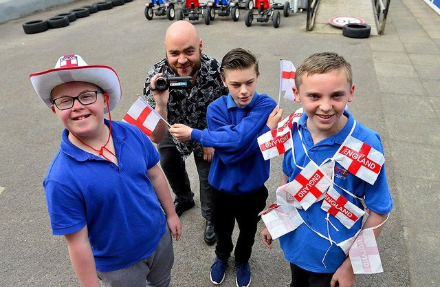 Catcote Academy teacher Rick Kitson who filmed the Vindaloo video with pupils Thomas Brookes, Ashley Boulton and Ethan O'Connor. Picture by FRANK REID