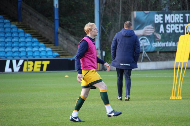 Luke Williams warming up for Hartlepool United at Halifax Town (photo: HUFC/Alex Chandy)