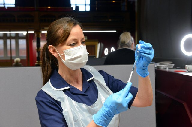 Nurse practioner Julie Faint preparing doses of the vaccine at a clinic at Hartlepool Town Hall Theatre.