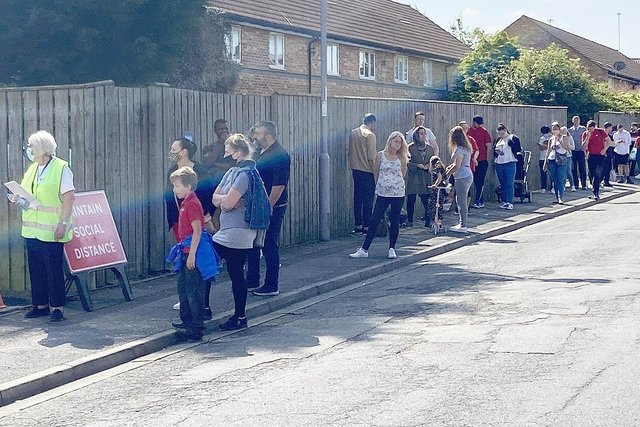 Members of the public queuing to use the walk-in Covid clinic in the car park at St Aidans Church, Hartlepool. Picture by FRANK REID