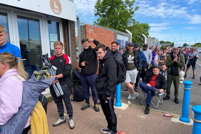 Devoted Hartlepool United fans wait in line for their tickets at Victoria Park. Picture by Frank Reid.