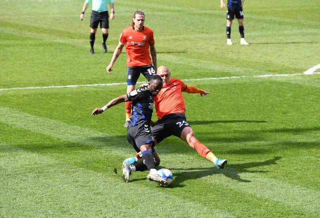 Kal Naismith of Luton Town tackles Neeskens Kebano of Middlesbrough.