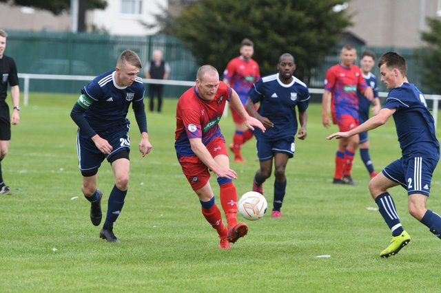 FC Hartlepool (red) in action against Washington United.