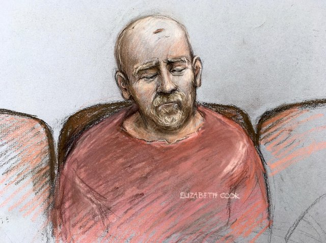 A court artist sketch by Elizabeth Cook of serving police constable Wayne Couzens, making his first appearance at the Old Bailey by video link from Belmarsh top security jail in south London back in March.