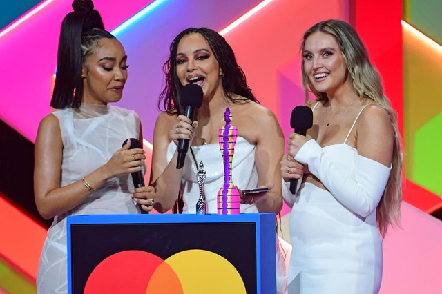 Little Mix members Leigh-Anne Pinnock (left), Jade Thirlwall (middle) and Perrie Edwards (right) at the Brit Awards. Photo: PA.