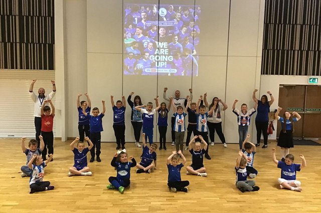 Jesmond Gardens Primary School staff and pupils celebrated Hartlepool United's promotion to the Football League by wearing kits on Monday.