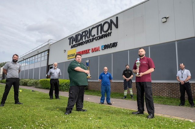 Michael Findlay, left, with members of the TMD Friction team