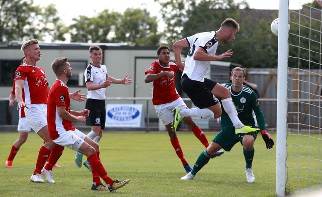 Gateshead's Jake Cooper scores the first goal during the Vanarama National League North Playoff match between Brackley Town and Gateshead at St. James Park on July 19, 2020 in Brackley, England.  Photo by David Rogers / Getty Images)