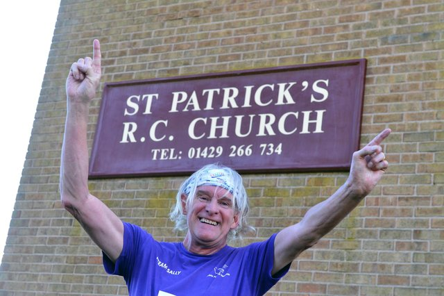 Phil Holbrook celebrates completing the St Patrick's Day hat-trick half marathon.