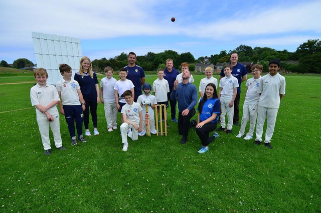 International cricket umpire and former England cricketer Michael Gough (kneeling) at High Tunstall College of Science with invited guests from Hartlepool Cricket Club, sponsors Lorimers and school cricket players.  Picture by FRANK REID
