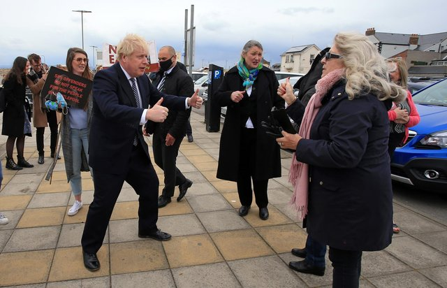 Prime Minister Boris Johnson gestures as he campaigns on behalf of Conservative Party candidate Jill Mortimer (centre) in Seaton Carew ahead of Hartlepool's by-election to be held on May 6. Photo by PA.